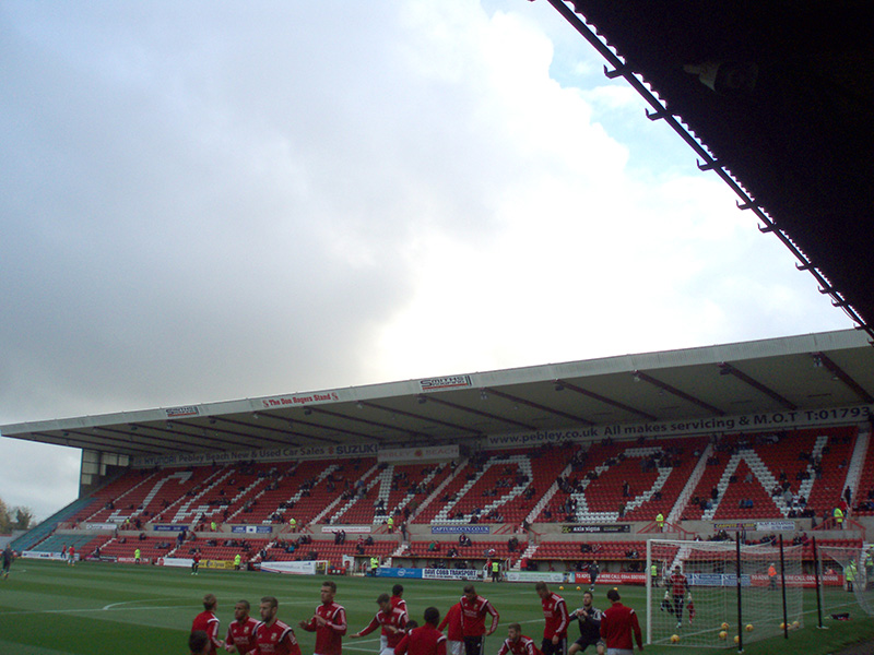 Swindon Town's player warm up before the League 1 game against Bristol City
