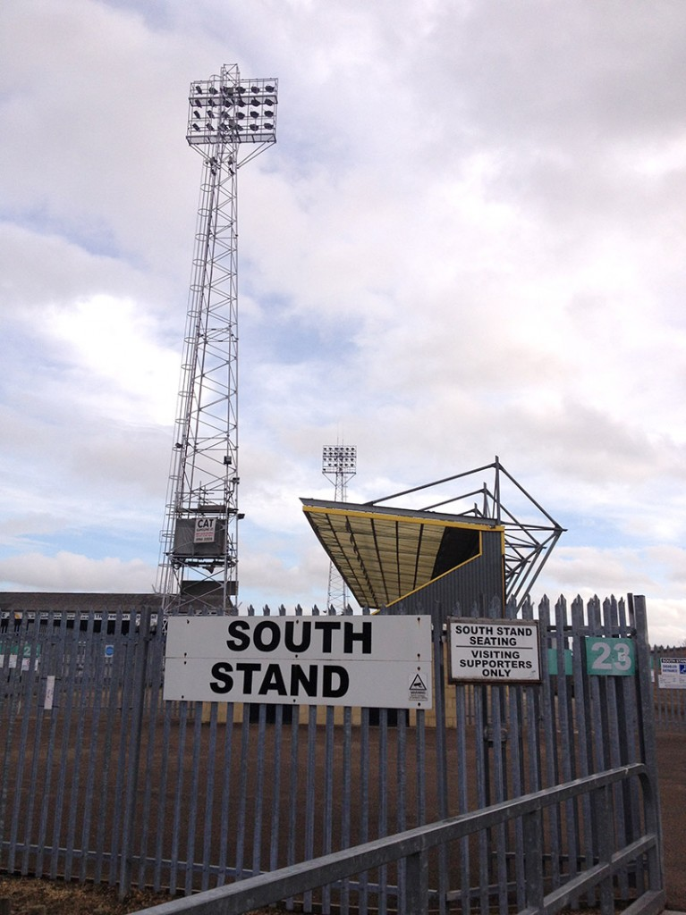 South stand and floodflight at the Abbey Stadium the home of Cambridge United