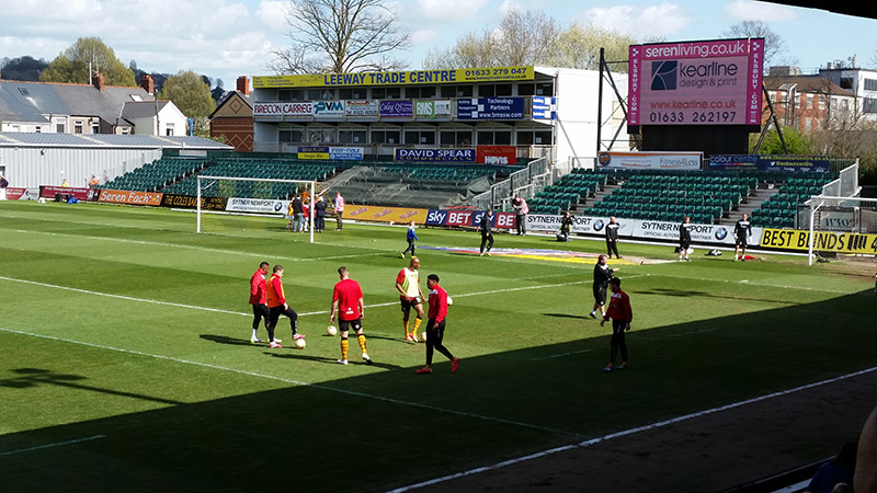 Newport County players warm up before the match against bury