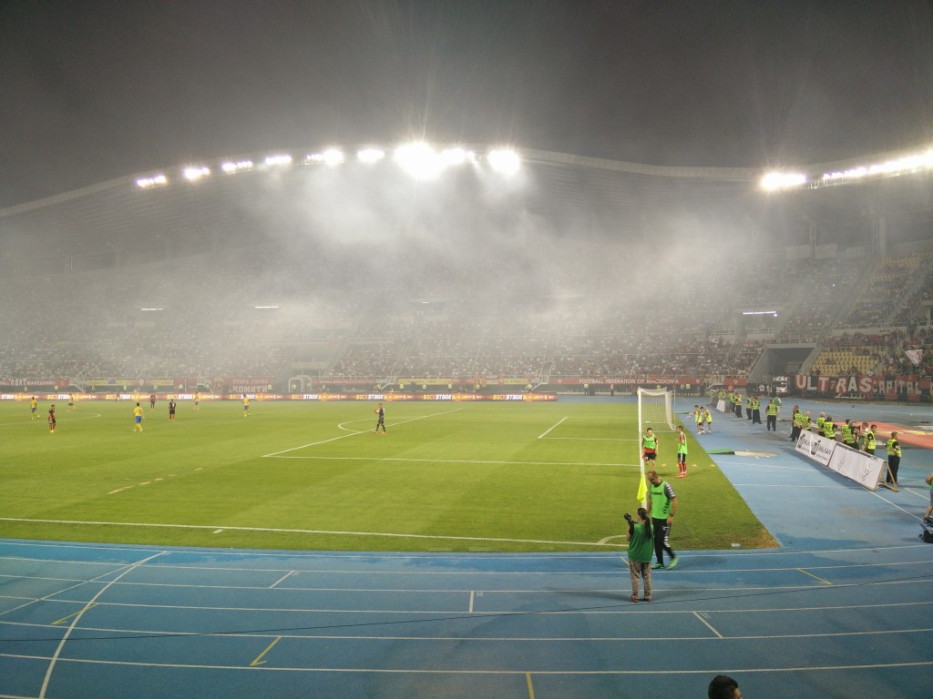 Smoke from flare in stadium.