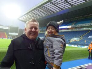 Andrew with his son at Ewood Park