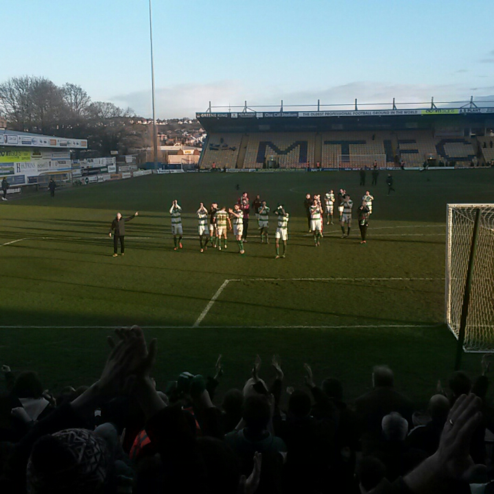 Yeovil town players applaud the fans at mansfield after 1-0 away win