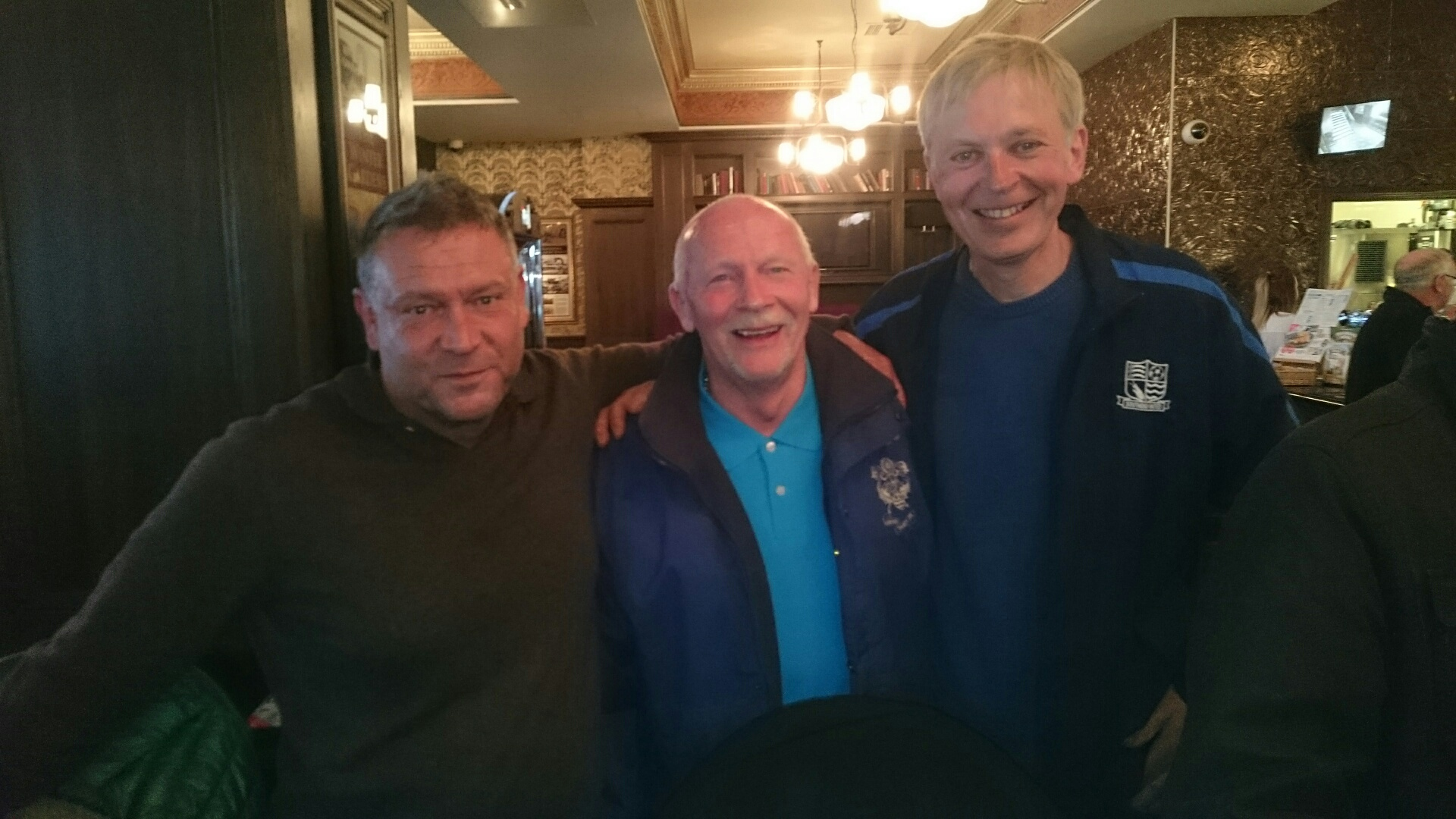 Andrew (right), his mate Harvey (left) with Derek Spence, former Southend United and Northern Ireland international, who did the foreword for the book, in the middle, when Andrew meet up in a pub before Andrew's 92nd game at Blackpool in April 2016.