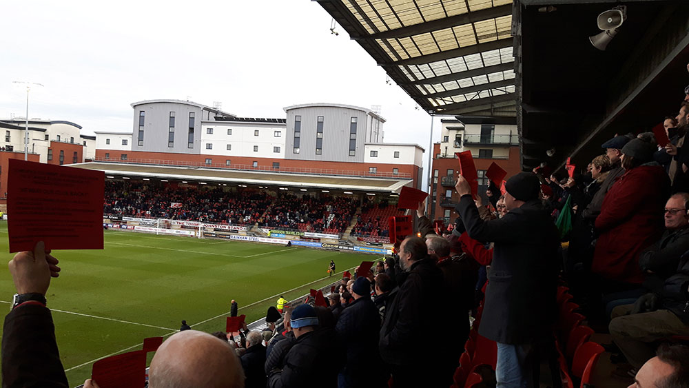 Leyton Orient fans protest at the clubs Italian owners in the 18th minute