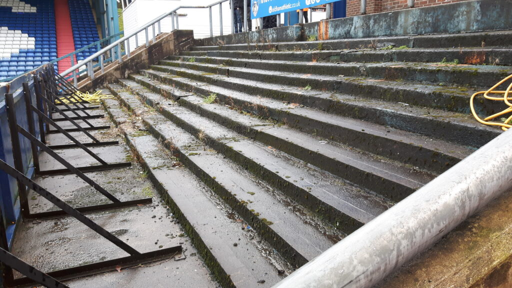 Part of the old terrace that sits to the side of the Main Stand at Oldham Athletic's ground