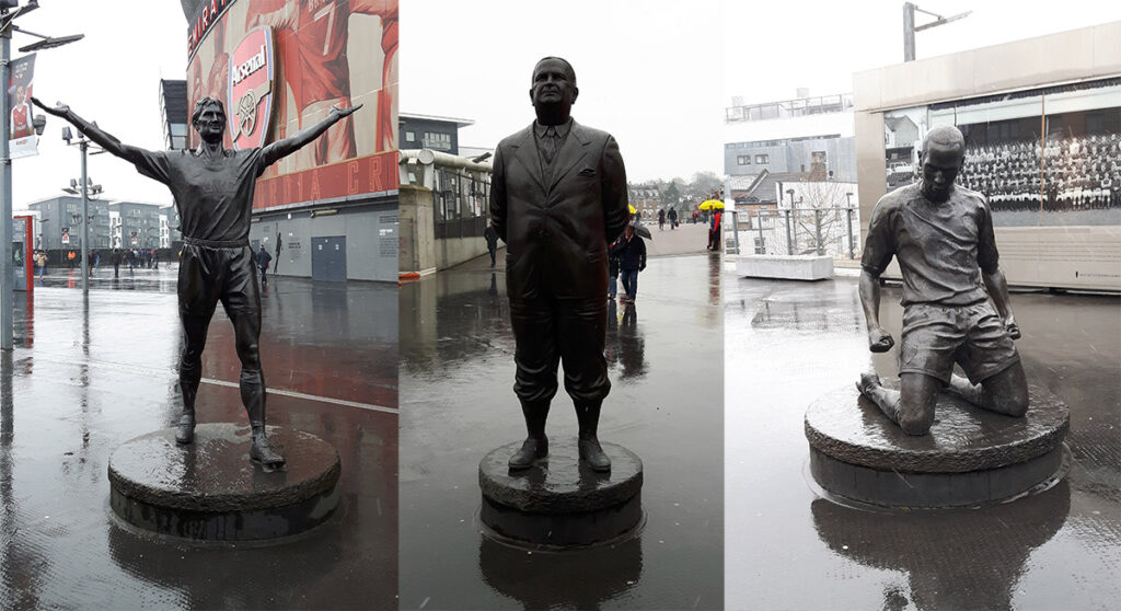 Statues of Tony Adams, Herbert Chapman and Thierry Henry outside the Emirates Stadium