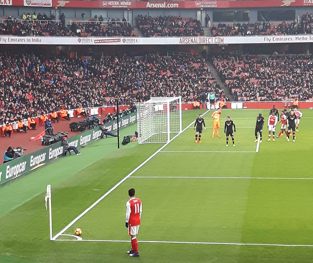 Ozil takes a corner for Arsenal v Hull City in the Premier League at the Emirates Stadium