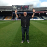 On the pitch at Kenilworth Road doing the 92 club challenge
