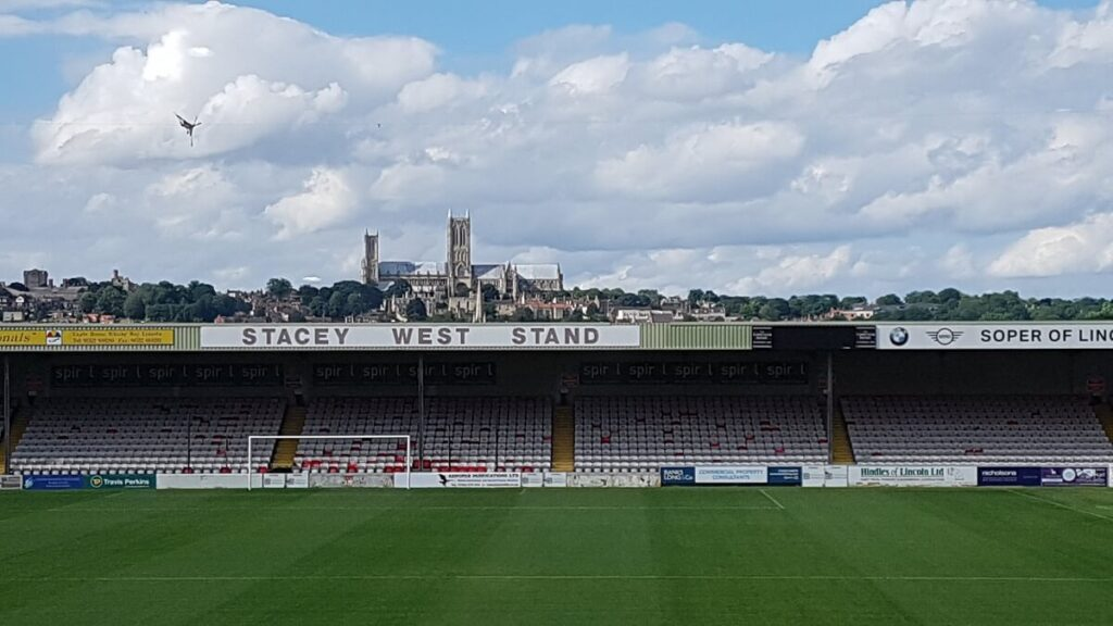 Lincoln cathedral visible over the back of the Stacey West Stand Sincil Bank