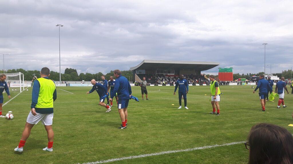 Premier league legends warm up before the non league challenge