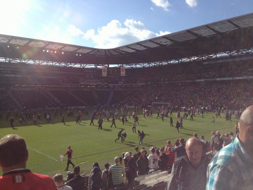 Sheffield United fans invade the pitch after securing promotion to the Championship at Stadium MK