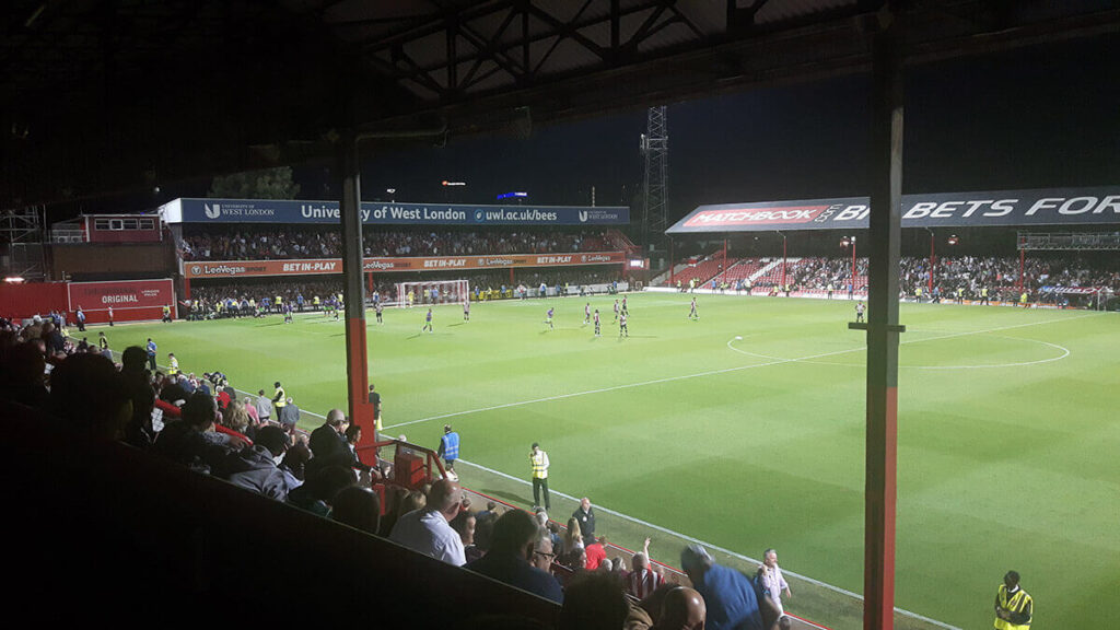 Bristol City fans and players celebrate grabbing a late equaliser at Griffin Park